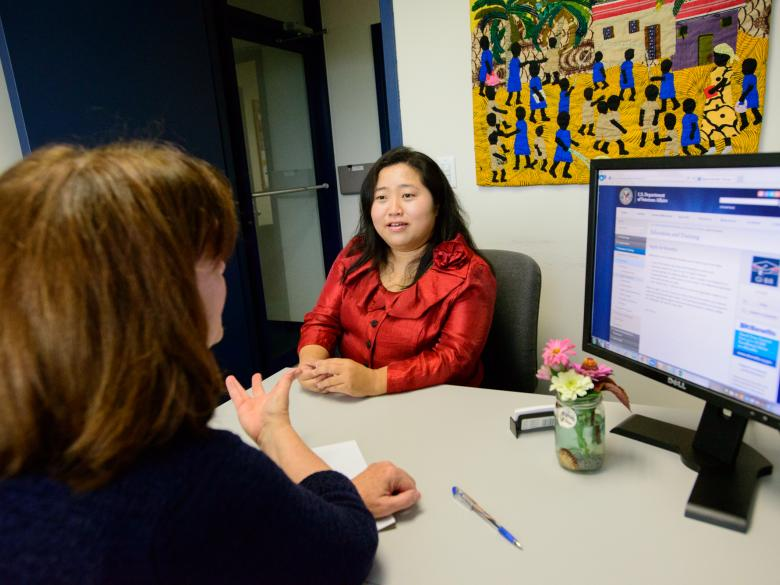 Student meeting with an admissions counselor