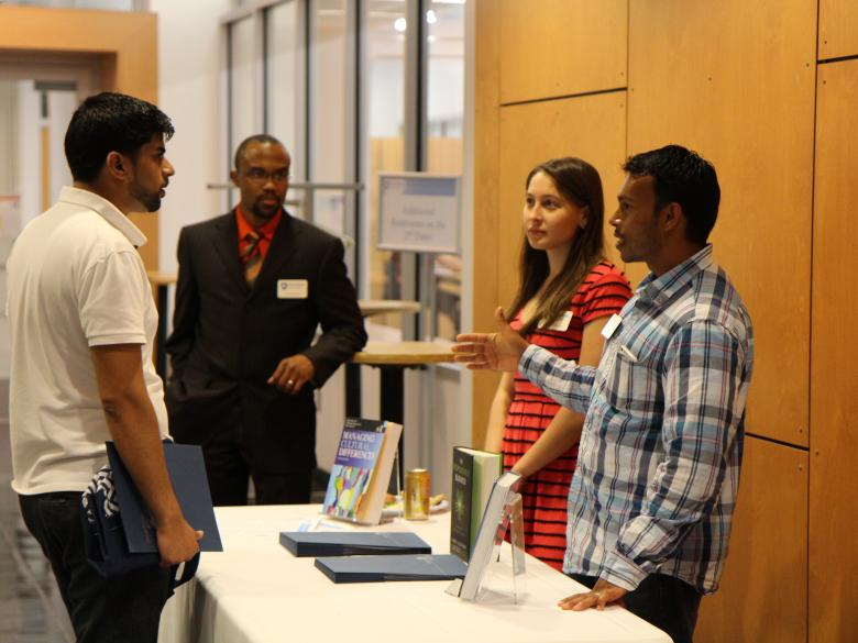 Students discussing the MBA program at an event